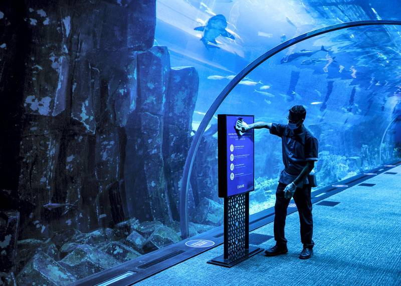 DUBAI, UNITED ARAB EMIRATES. 11 JUNE 2020. Signs requiring people to social distance at Dubai Mall's Dubai Aquarium and Underwater Zoo(Photo: Reem Mohammed/The National)Reporter:Section: