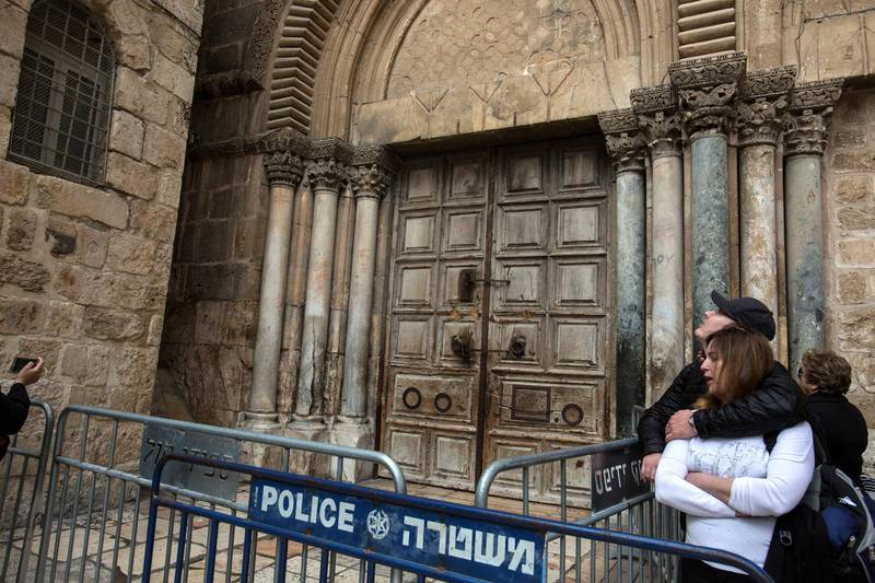 Christian pilgrims by the closed Church of the Holy Sepulchre in the Old City of Jerusalem on Monday February 26,2018.The Church of the Holy Sepulchre  remained closed for a second day after church leaders in Jerusalem closed it to protest against Israeli's announced plans by the cityÕs municipality earlier this month to collect property tax (arnona) from church-owned properties on which there are no houses of worship. (Photo by Heidi Levine for The National).