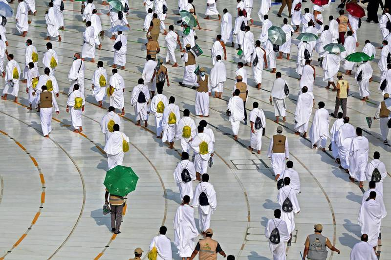 A picture shows pilgrims circumambulating around the Kaaba, the holiest shrine in the Grand mosque in the holy Saudi city of Mecca, on July 31, 2020 during the annual Muslim Hajj pilgrimage. (Photo by STR / AFP)