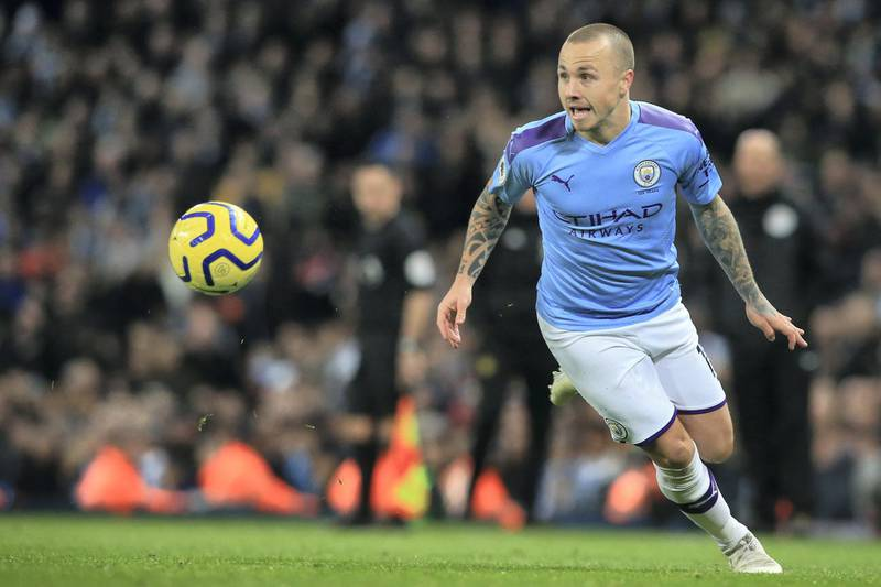 Manchester City's Spanish defender Angelino plays the ball during the English Premier League football match between Manchester City and Manchester United at the Etihad Stadium in Manchester, north west England, on December 7, 2019. (Photo by Lindsey Parnaby / AFP) / RESTRICTED TO EDITORIAL USE. No use with unauthorized audio, video, data, fixture lists, club/league logos or 'live' services. Online in-match use limited to 120 images. An additional 40 images may be used in extra time. No video emulation. Social media in-match use limited to 120 images. An additional 40 images may be used in extra time. No use in betting publications, games or single club/league/player publications. /