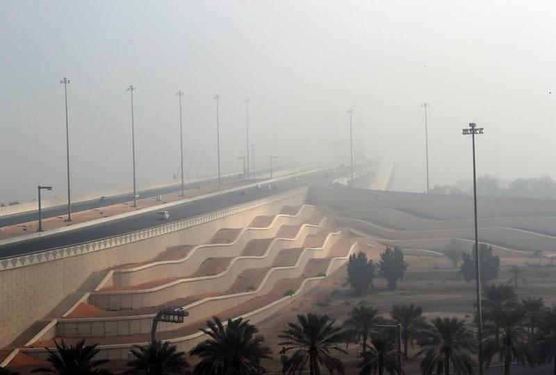 Abu Dhabi - United Arab Emirates - 22Dec2017 - Shaikh Zayed bridge covered with dense fog engulfed Abu Dhabi city in the morning having poor visibilty for motorist. Ravindranath K / The National