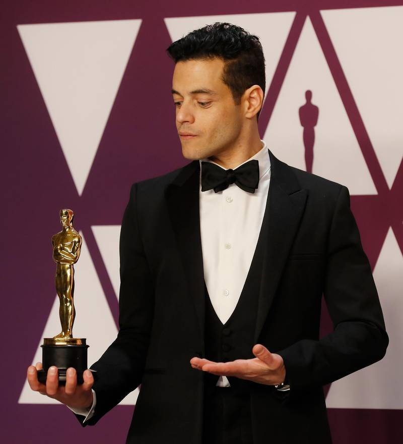 epa07395604 Rami Malek holds his Oscar for 'Best Actor in a leading Role' for 'Bohemian Rhapsody' as he poses in the press room during the 91st annual Academy Awards ceremony at the Dolby Theatre in Hollywood, California, USA, 24 February 2019. Tuxedo by Anthony Vaccarello for Saint Laurent. The Oscars are presented for outstanding individual or collective efforts in 24 categories in filmmaking.  EPA-EFE/ETIENNE LAURENT