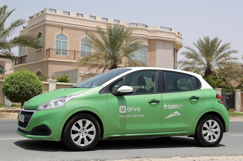 DUBAI , UNITED ARAB EMIRATES , AUG 20  – 2017 :- Car from UDrive short term rental car services parked near the Sheikh Zayed Road in Dubai. ( Pawan Singh / The National ) Story by Adam Workman
