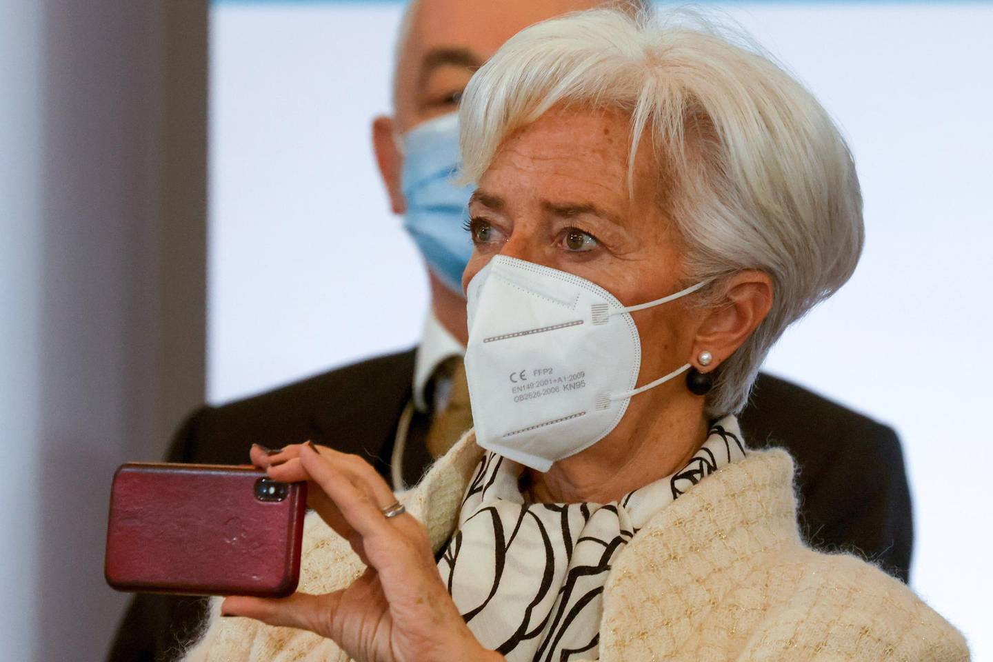 President of the European Central Bank (ECB) Christine Lagarde holds her smartphone as she attends the One Planet Summit, at The Elysee Palace, in Paris, Monday Jan. 11, 2021. Protecting the world's biodiversity is on the agenda for world leaders at the One Planet Summit, which was being held by videoconference due to the coronavirus pandemic. (Ludovic Marin, Pool Photo via AP)
