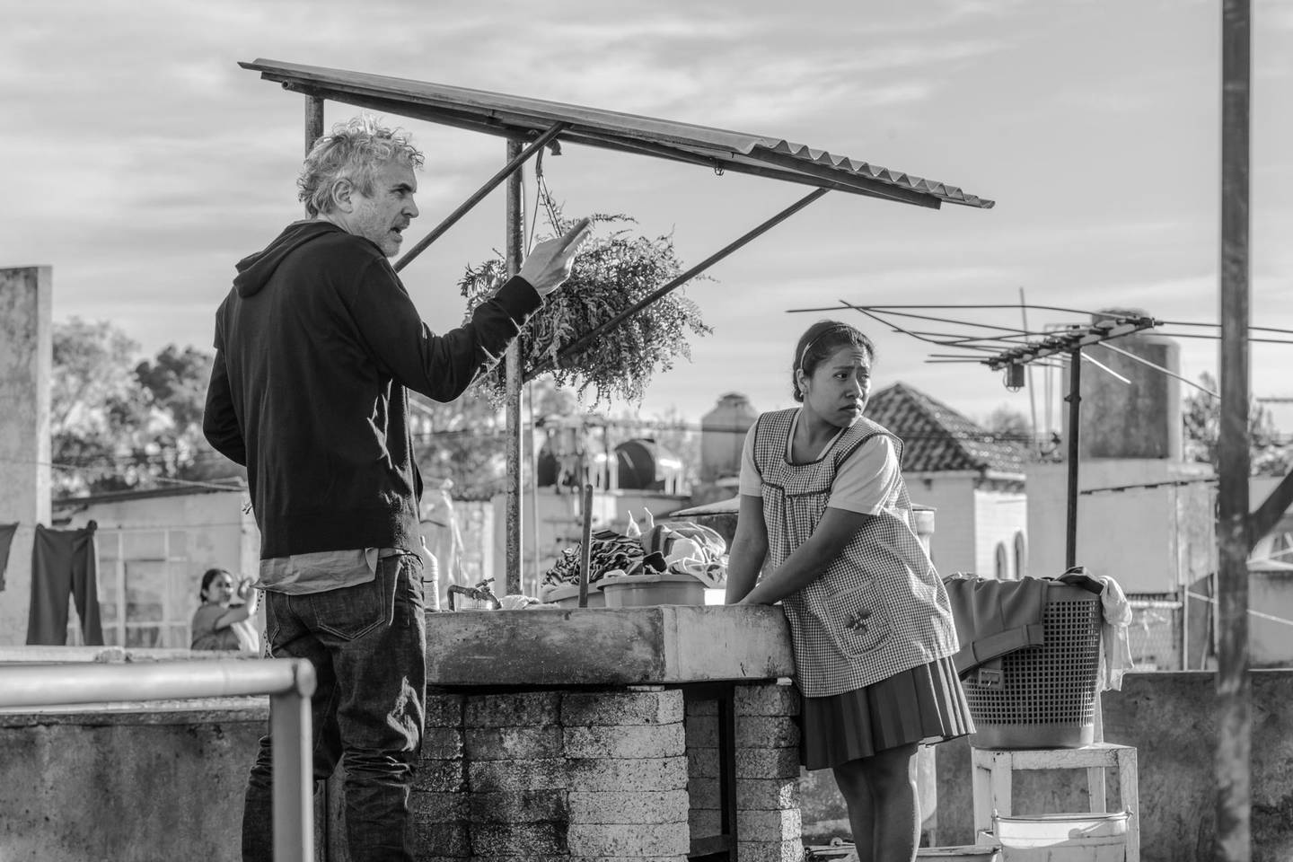 """This image released by Netflix shows filmmaker Alfonso Cuaron, left, and actress Yalitza Aparicio on the set of """"Roma."""" On Thursday, Dec. 6, 2018, Cuaron was nominated for a Golden Globe award for best director for the film. The 76th Golden Globe Awards will be held on Sunday, Jan. 6. (Carlos Somonte/Netflix via AP)"""