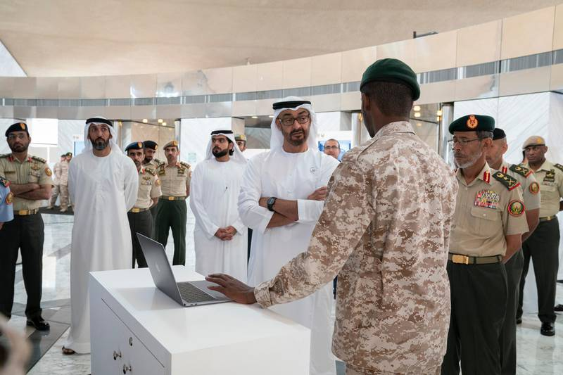 ABU DHABI, UNITED ARAB EMIRATES - April 28, 2019: HH Sheikh Mohamed bin Zayed Al Nahyan, Crown Prince of Abu Dhabi and Deputy Supreme Commander of the UAE Armed Forces (C), attends e-skills exhibition for national service recruits, at Armed Forces Officers Club. Seen with HE Lt General Hamad Thani Al Romaithi, Chief of Staff UAE Armed Forces (R) and HE Mohamed Mubarak Al Mazrouei, Undersecretary of the Crown Prince Court of Abu Dhabi (2nd L). ( Mohamed Al Hammadi / Ministry of Presidential Affairs ) ---