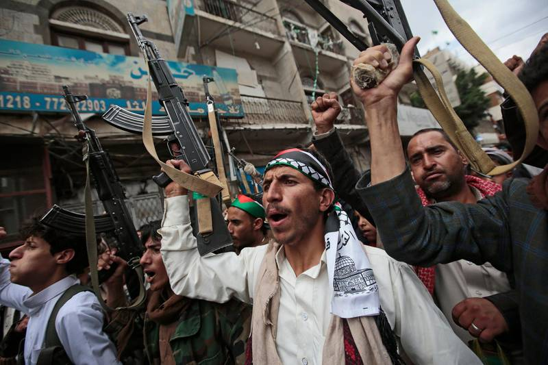 Houthi supporters hold their weapons as they chant slogans during a protest against Israeli attacks on Palestinians in Gaza, Monday, May 17, 2021, in Sanaa, Yemen.  (AP Photo/Hani Mohammed)