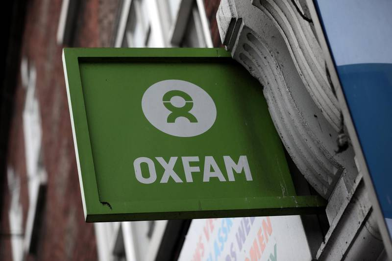 A sign is seen above a branch of Oxfam, in central London, Britain February 13, 2018.  REUTERS/Simon Dawson