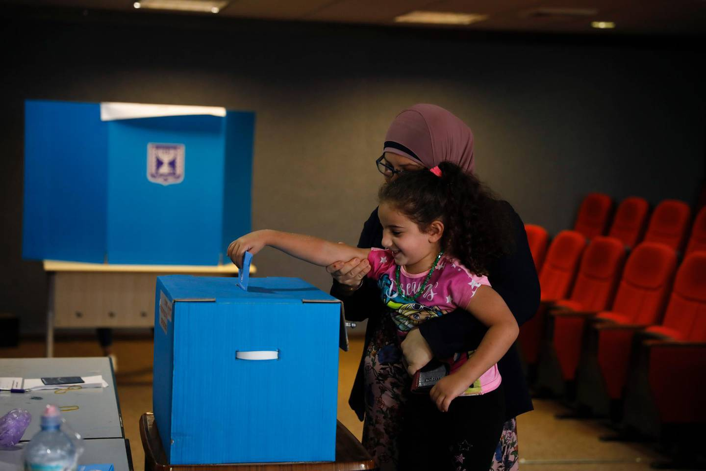 Israeli Arabs vote in Kfar Manda, an Arab town in Israel, Tuesday, Sept. 17, 2019. Israelis began voting Tuesday in an unprecedented repeat election that will decide whether longtime Prime Minister Benjamin Netanyahu stays in power despite a looming indictment on corruption charges. (AP Photo/Ariel Schalit)