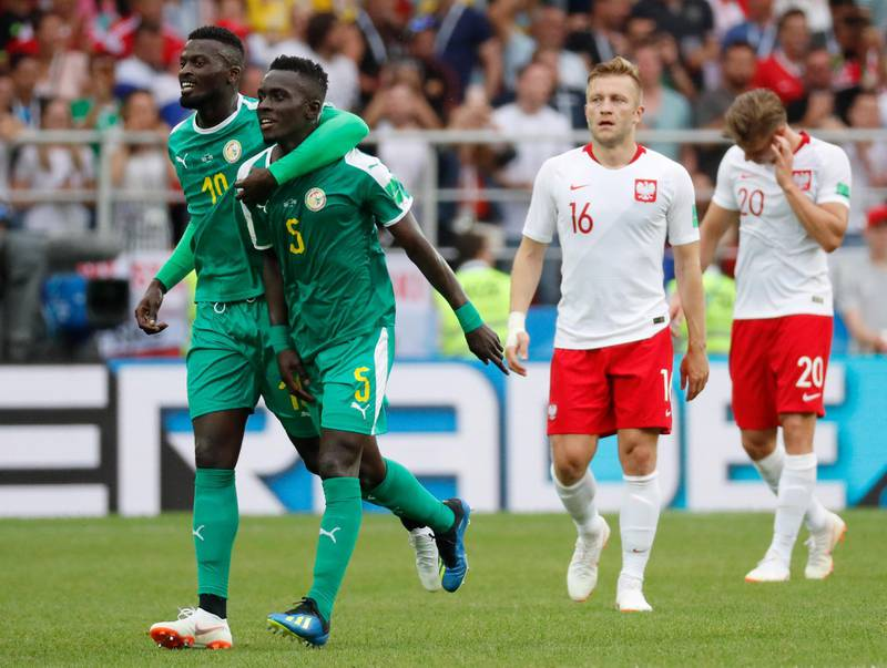 epaselect epa06821556 Idrissa Gueye (2-L) of Senegal celebrates with team mates the 1-0 lead during the FIFA World Cup 2018 group H preliminary round soccer match between Poland and Senegal in Moscow, Russia, 19 June 2018.  (RESTRICTIONS APPLY: Editorial Use Only, not used in association with any commercial entity - Images must not be used in any form of alert service or push service of any kind including via mobile alert services, downloads to mobile devices or MMS messaging - Images must appear as still images and must not emulate match action video footage - No alteration is made to, and no text or image is superimposed over, any published image which: (a) intentionally obscures or removes a sponsor identification image; or (b) adds or overlays the commercial identification of any third party which is not officially associated with the FIFA World Cup)  EPA/FELIPE TRUEBA   EDITORIAL USE ONLY