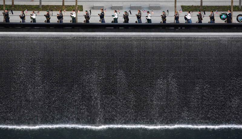 Bagpipers perform next to one of the Memorial's twin pools at Ground Zero during ceremonies marking the 10th anniversary of the 9/11 attacks on the World Trade Center, in New York, September 11, 2011. REUTERS/Jessica Rinaldi (UNITED STATES - Tags: ANNIVERSARY DISASTER TPX IMAGES OF THE DAY) *** Local Caption ***  WTC111_SEPT11-_0911_11.JPG