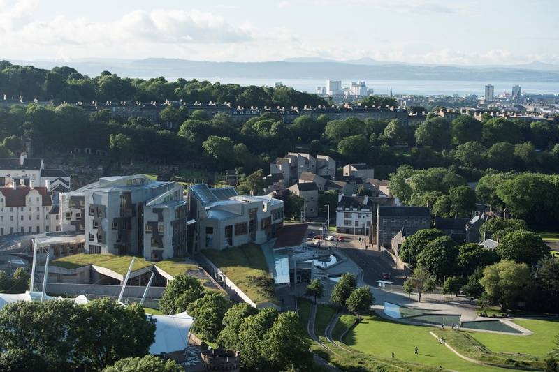 The Scottish Parliament is pictures at sunset from Salisbury Crags in Holyrood Park, Edinburgh, Scotland on June 25, 2016, following the pro-Brexit result of the UK's EU referendum vote. - The result of Britain's June 23 referendum vote to leave the European Union (EU) has pitted parents against children, cities against rural areas, north against south and university graduates against those with fewer qualifications. London, Scotland and Northern Ireland voted to remain in the EU but Wales and large swathes of England, particularly former industrial hubs in the north with many disaffected workers, backed a Brexit. (Photo by OLI SCARFF / AFP)