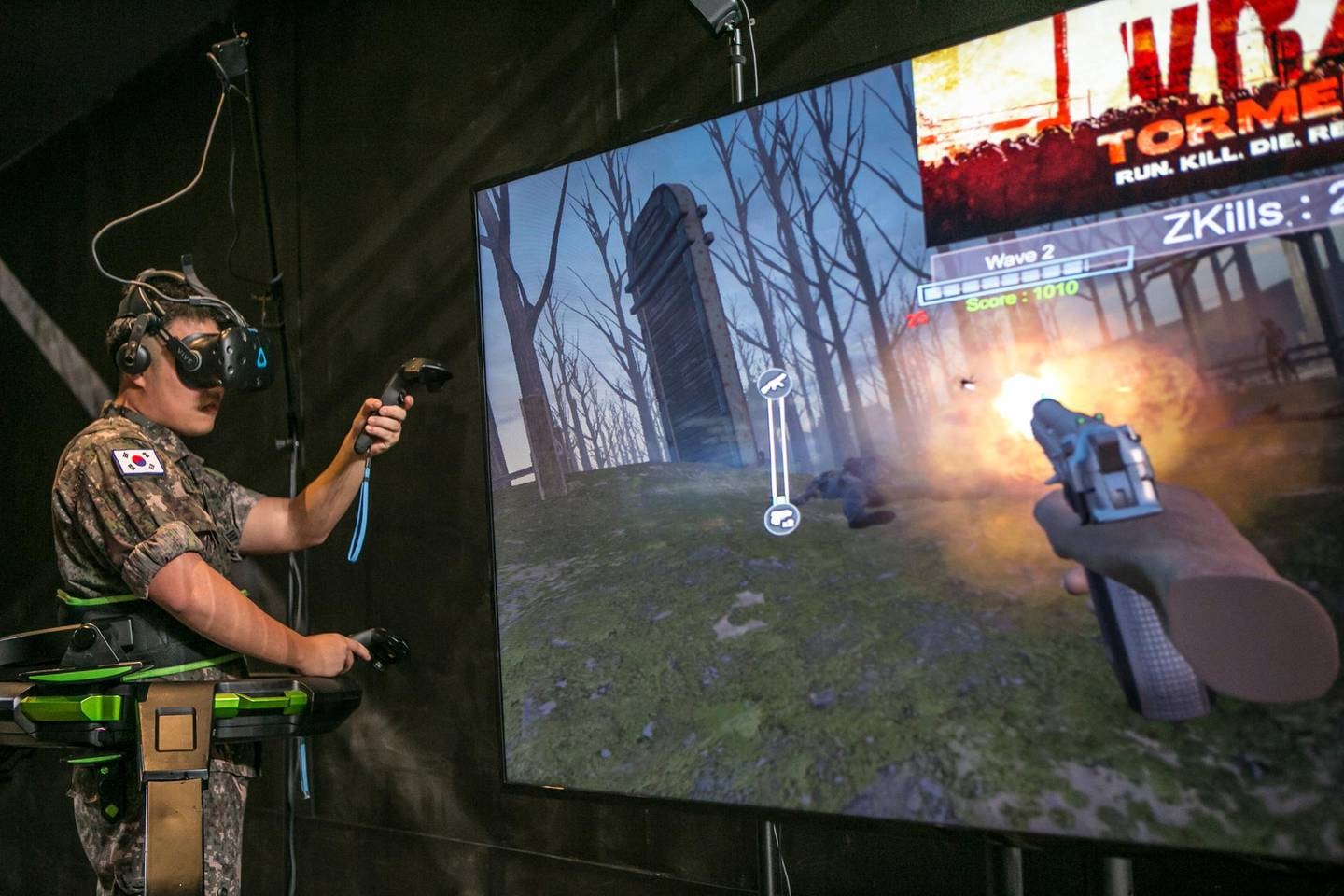 A gamer wearing virtual reality (VR) headset plays a shooting game during SK Telecom Co.'s 5GX Game Festival in Goyang, South Korea, on Friday, Aug. 10, 2018. Professional video gaming began in South Korea more than a decade ago, and has given rise to leagues that now pack stadiums and draw hundreds of thousands of eyeballs toTwitch livestreamsfor tournaments. Photographer: Jean Chung/Bloomberg