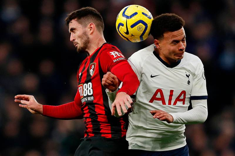 Bournemouth's English midfielder Lewis Cook (L) vies to header the ball with Tottenham Hotspur's English midfielder Dele Alli during the English Premier League football match between Tottenham Hotspur and Bournemouth at the Tottenham Hotspur Stadium in London, on November 30, 2019.  - RESTRICTED TO EDITORIAL USE. No use with unauthorized audio, video, data, fixture lists, club/league logos or 'live' services. Online in-match use limited to 120 images. An additional 40 images may be used in extra time. No video emulation. Social media in-match use limited to 120 images. An additional 40 images may be used in extra time. No use in betting publications, games or single club/league/player publications.  / AFP / Adrian DENNIS / RESTRICTED TO EDITORIAL USE. No use with unauthorized audio, video, data, fixture lists, club/league logos or 'live' services. Online in-match use limited to 120 images. An additional 40 images may be used in extra time. No video emulation. Social media in-match use limited to 120 images. An additional 40 images may be used in extra time. No use in betting publications, games or single club/league/player publications.