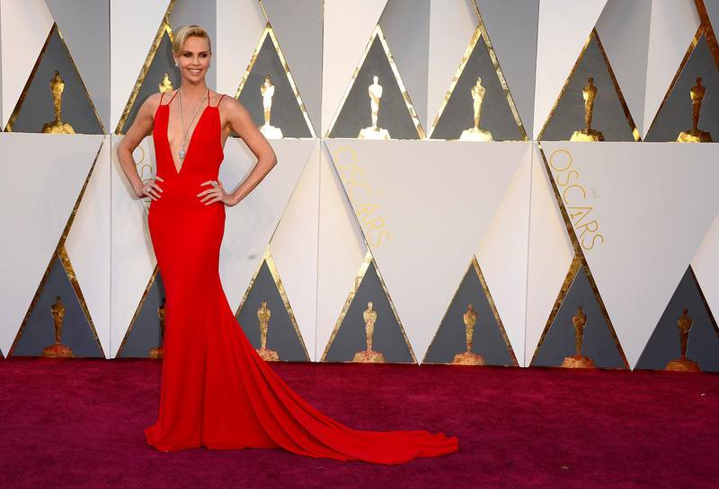 epa05186362 Charlize Theron arrives for the 88th annual Academy Awards ceremony at the Dolby Theatre in Hollywood, California, USA, 28 February 2016. The Oscars are presented for outstanding individual or collective efforts in 24 categories in filmmaking.  EPA/MIKE NELSON