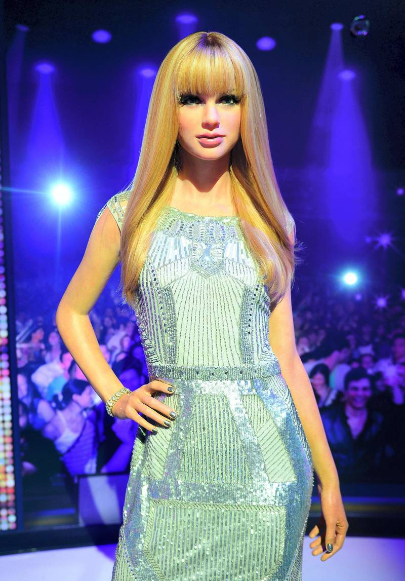 A wax figure of singer Taylor Swift is on display during the launch of an interactive music experience exhibition at Madame Tussauds in New York, February 19, 2014. The new interactive wax figures music exhibition features the first-ever US appearance of British singer Adele alongside current's music hottest icons such as Lady Gaga, Justin Timberlake, Rihanna and Beyonce. AFP PHOTO/Emmanuel Dunand (Photo by EMMANUEL DUNAND / AFP)
