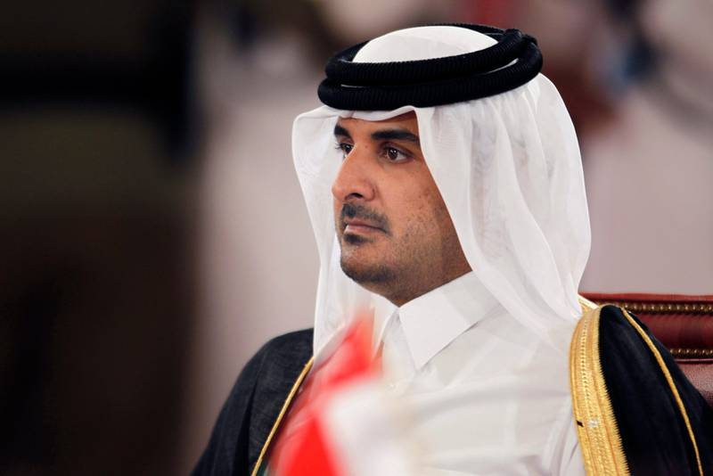 epa03758163 (FILE) A file photo dated 24 December 2012 shows Qatari Crown Prince Sheikh Tamim bin Hamad bin Khalifa Al-Thani attending the opening session of the 33rd Gulf leaders summit in Sakhir Palace, South of Manama, Bahrain. The Doha-based Al Jazeera broadcaster reported on 24 June 2013 that Qatari Emir Sheikh Hamad bin Khalifa Al Thani has told members of the royal family that he plans to hand over power to his son, Sheikh Tamim. The royal court said the emir will address the nation on 25 June without elaborating.  EPA/STR *** Local Caption ***  03758163.jpg