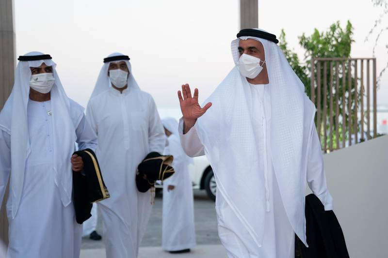 ABU DHABI, UNITED ARAB EMIRATES - December 02, 2020: HH Lt General Sheikh Saif bin Zayed Al Nahyan, UAE Deputy Prime Minister and Minister of Interior (R), arrives at the performance of 'Seeds of the Union' during the official 49th UAE National Day Celebrations at Jubail Mangrove Park. Seen with HH Sheikh Nahyan bin Mubarak Al Nahyan, UAE Minister of State for Tolerance (L).   ( Rashed Al Mansoori / Ministry of Presidential Affairs ) ---