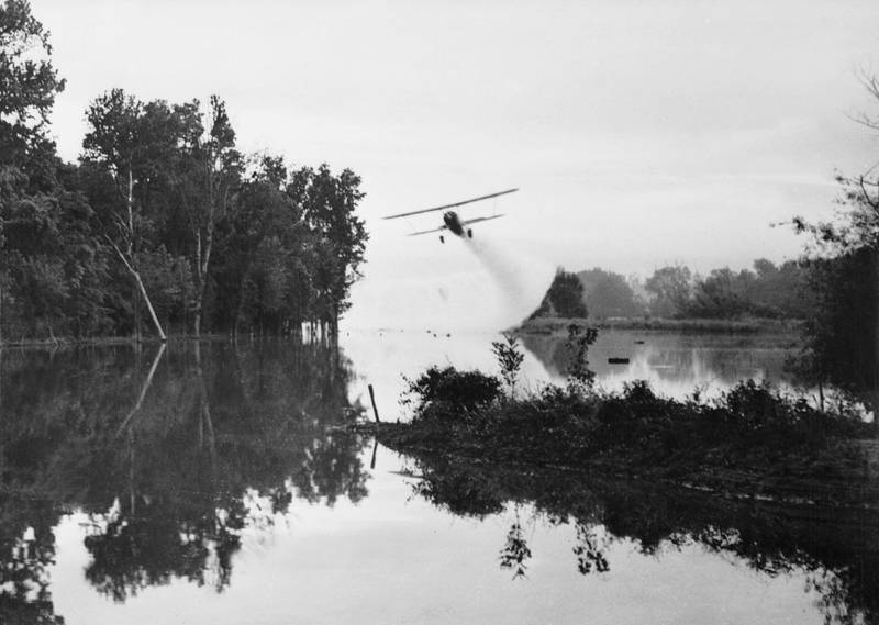 FOR MALARIA / SMALPOX GALLERY. 2nd March 1945:  An American army plane spreading insecticide on a stream to destroy mosquitos which carry malaria.  (Photo by Keystone Features/Getty Images)