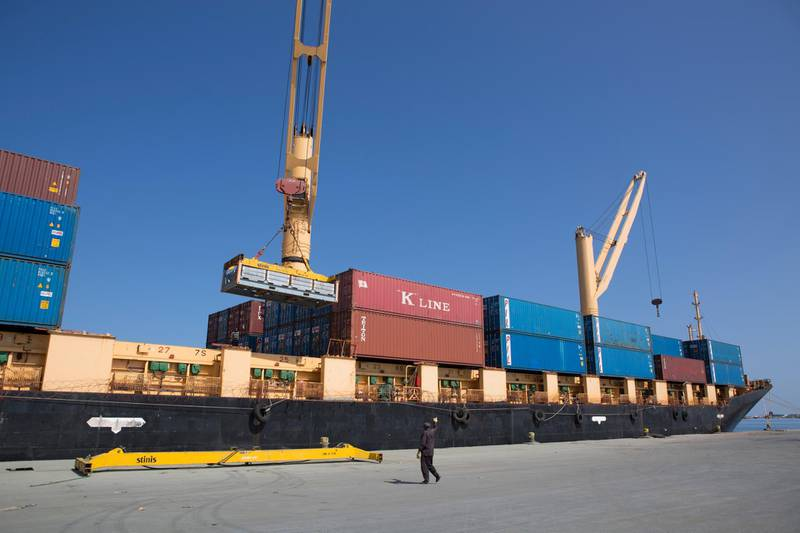 A man helps loading up a cargo ship in the Port of Berbera in Somaliland on December 5, 2015. The main exports from Somaliland are livestocks to the Gulf countries like Saudi Arabia, Dubai and Qatar. Somaliland is an internationally unrecognised nation-state in the Horn of Africa that declared independence from Somalia in 1991. / AFP PHOTO / ZACHARIAS ABUBEKER