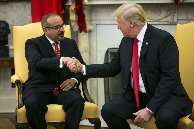 U.S. President Donald Trump, right, shakes hands with Salman bin Hamad Al-Khalifa, Crown Prince of Bahrain, during a meeting in the Oval Office of the White House in Washington, D.C., U.S., on Thursday, Nov. 30, 2017. The White House is discussing whether to replace Secretary of StateRex Tillersonwith CIA DirectorMike Pompeo, two White House officials said. Photographer: Al Drago/Bloomberg