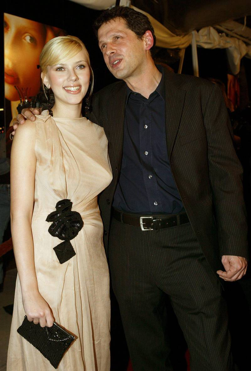 Actress Scarlett Johansson and director Peter Webber arrive for the Los Angeles premiere of their film, 'Girl With A Pearl Earring,' in Beverly Hills, California 10 December 2003. The film is speculative account of the life of Griet, a 16-year-old girl who appears in Johannes Vermeer's painting of the same title and is set in 17th century Holland.  EPA/BRENDAN MCDERMID  EPA