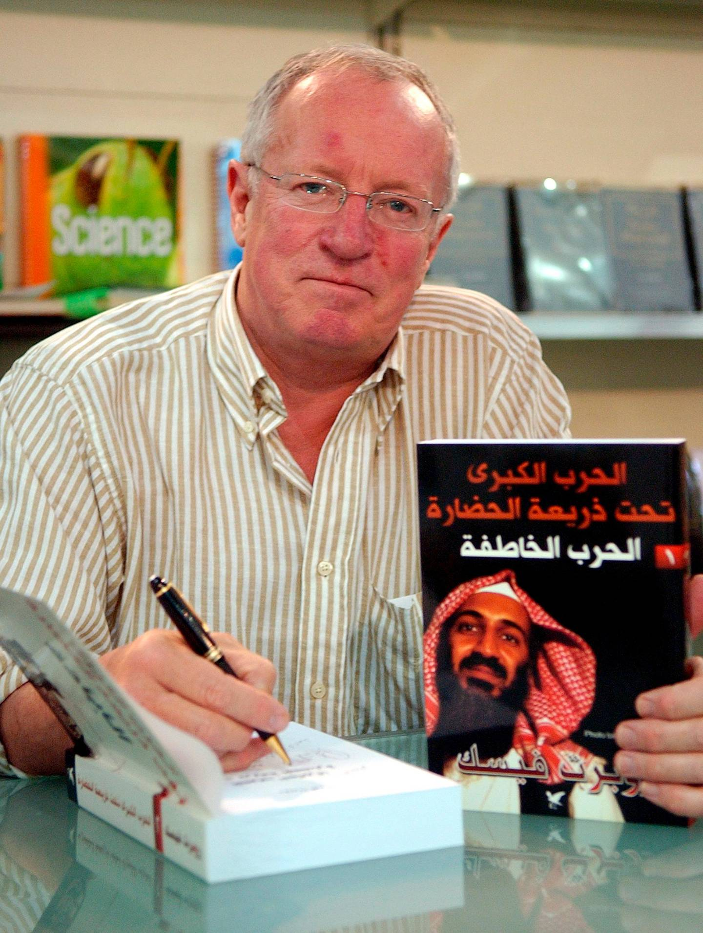 epa08792183 (FILE) - British Middle East news journalist, Robert Fisk, during signing the Arabic version of his new book 'The Great War for Civilisation: the Conquest of the Middle East', in the Arab Book Exhibition in Beirut, Lebanon, 21 April 2007 (Reissued 01 November 2020). According to news reports on 01 November 2020, British Middle East news journalist and author Robert Fisk, died at the age of 74.  EPA/WAEL HAMZEH