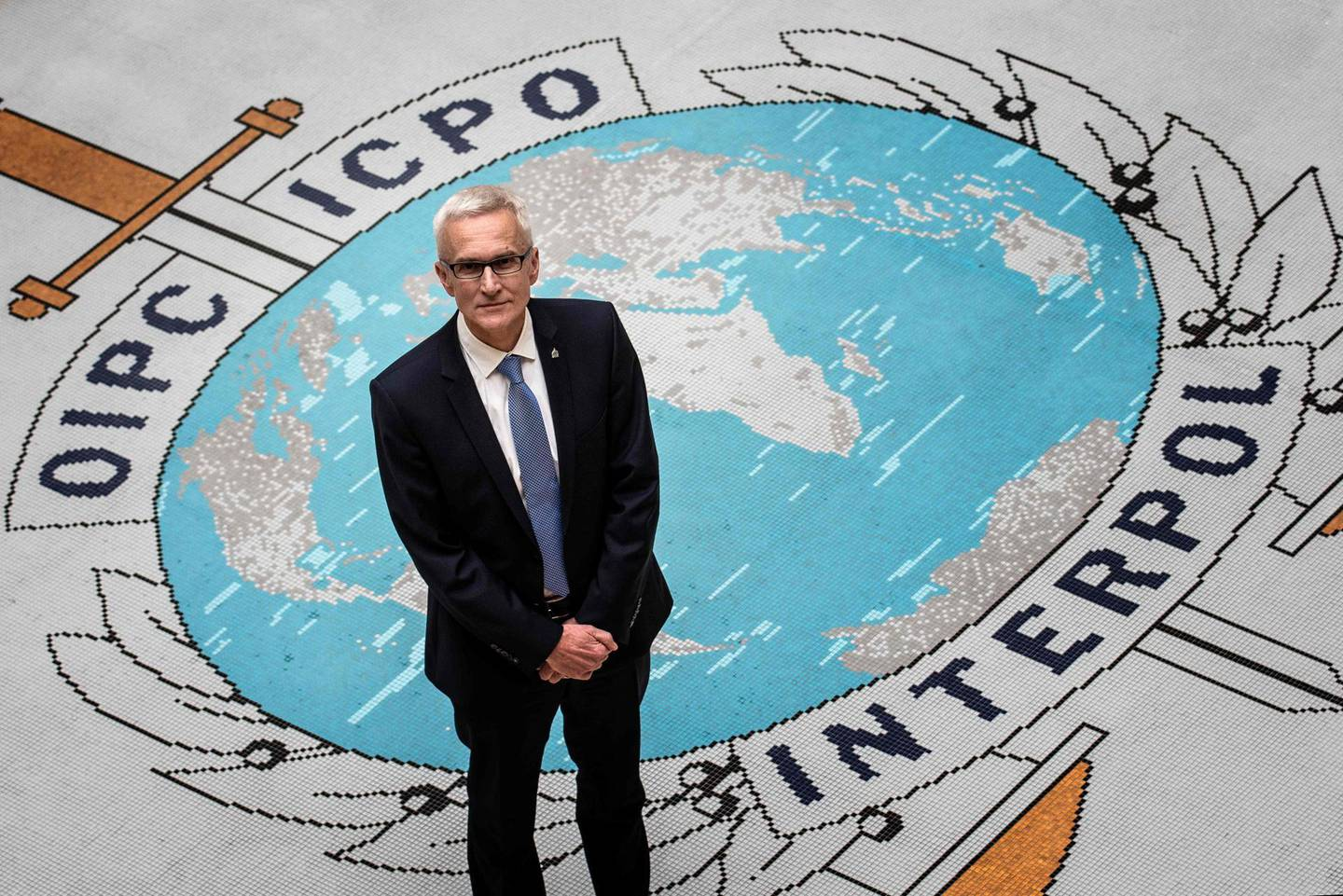 Secretary General of Interpol Jurgen Stock poses for a photograph at the Interpol headquarters in the southern French city of Lyon on November 8, 2018. / AFP / JEFF PACHOUD