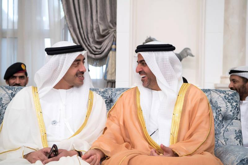 ABU DHABI, UNITED ARAB EMIRATES - June 15, 2018: HH Sheikh Abdullah bin Zayed Al Nahyan, UAE Minister of Foreign Affairs and International Cooperation (L) and HH Sheikh Hamed bin Zayed Al Nahyan, Chairman of the Crown Prince Court of Abu Dhabi and Abu Dhabi Executive Council Member (R), attend an Eid Al Fitr reception at Mushrif Palace.   ( Saeed Al Neyadi / Crown Prince Court - Abu Dhabi ) ---