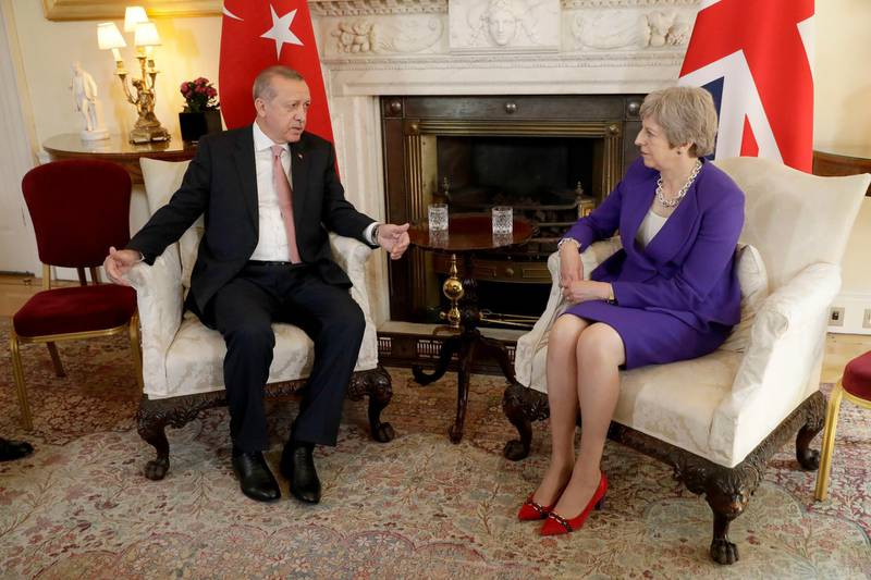 LONDON, ENGLAND - MAY 15:  British Prime Minister Theresa May listens to President of Turkey Recep Tayyip Erdogan at the start of their meeting at 10 Downing Street on May 15, 2018 in London, England. Turkish President Mr Erdogan is in the UK for a three-day visit, which includes a closing lecture at the Tatlidil Forum in Oxford, an audience with The Queen and talks with British Prime Minister Theresa May.  (Photo by Matt Dunham - WPA Pool/Getty Images)