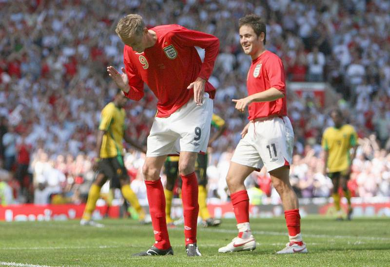 England's Peter Crouch, centre, celebrates scoring against Jamaica during their international friendly soccer match at Old Trafford Stadium, Manchester, England, Saturday June 3, 2006. (AP Photo/Dave Thompson)