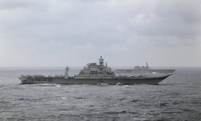 Indian naval ship INS Vikramaditya, foreground and Japan's helicopter carrier Izumo, behind participate in the Malabar 2017 tri-lateral exercises between India, Japan and US in the Bay of Bengal, Monday, July 17, 2017. (AP Photo/Rishi Lekhi)