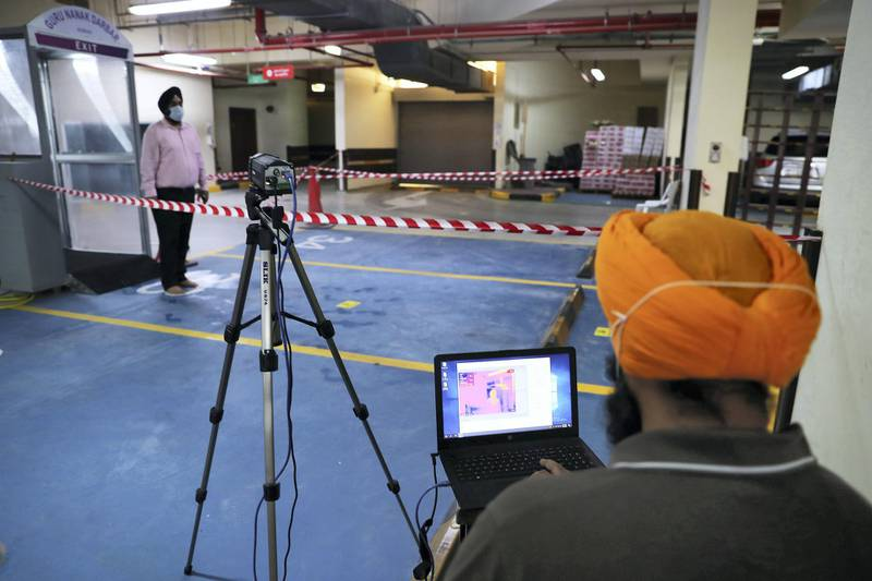 DUBAI, UNITED ARAB EMIRATES , June 30 – 2020 :- Thermal camera installed to check the temperature of the visitors inside the Gurunanak Darbar in Jebel Ali in Dubai. Places of worship opening up tomorrow in the UAE. (Pawan Singh / The National) For News. Story by Ramola