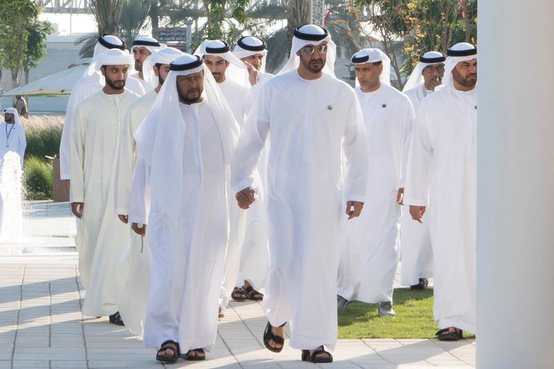ABU DHABI, UNITED ARAB EMIRATES - November 30, 2017: HH Sheikh Sultan bin Zayed Al Nahyan, UAE President's Representative (L) and HH Sheikh Mohamed bin Zayed Al Nahyan, Crown Prince of Abu Dhabi and Deputy Supreme Commander of the UAE Armed Forces (2nd L), attend a Commemoration Day ceremony at Wahat Al Karama, a memorial dedicated to the memory of UAE's National Heroes in honour of their sacrifice and in recognition of their heroism.  ( Saeed Al Neyadi / Crown Prince Court - Abu Dhabi ) ---