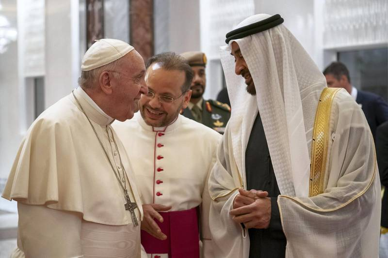 ABU DHABI, UNITED ARAB EMIRATES - February 3, 2019: Day one of the UAE papal visit - HH Sheikh Mohamed bin Zayed Al Nahyan, Crown Prince of Abu Dhabi and Deputy Supreme Commander of the UAE Armed Forces (R), receives His Holiness Pope Francis, Head of the Catholic Church (L), at the Presidential Airport.  ( Ryan Carter / Ministry of Presidential Affairs ) ---