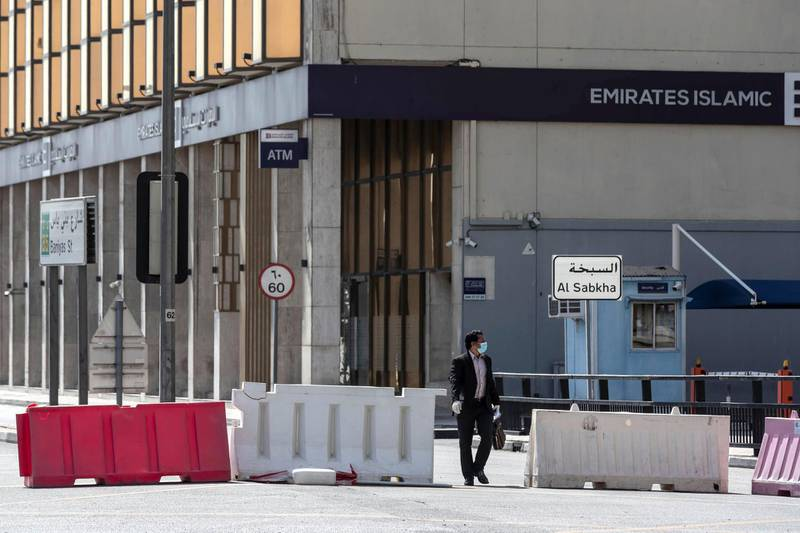 DUBAI, UNITED ARAB EMIRATES. 26 APRIL 2020. The barrier along the Baniyas road entrance to the quarentined Al Ras area in Deira. A man walks along the barrier. (Photo: Antonie Robertson/The National) Journalist: Ramola Talwar. Section: National.