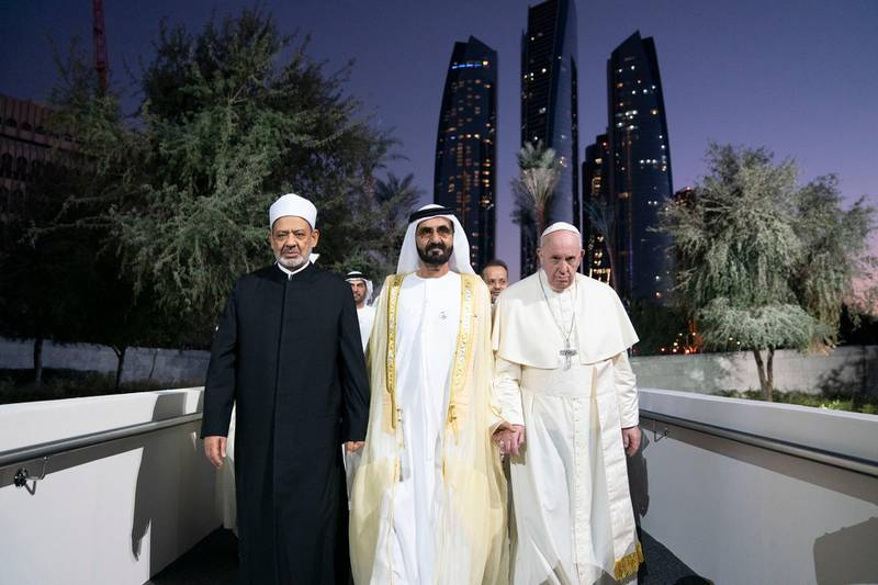 ABU DHABI, UNITED ARAB EMIRATES - February 04, 2019: Day two of the UAE papal visit - HH Sheikh Mohamed bin Rashid Al Maktoum, Vice-President, Prime Minister of the UAE, Ruler of Dubai and Minister of Defence (C), His Holiness Pope Francis, Head of the Catholic Church (R) and His Eminence Dr Ahmad Al Tayyeb, Grand Imam of the Al Azhar Al Sharif (L), arrive at the Human Fraternity Meeting, at The Founders Memorial.  ( Mohamed Al Hammadi / Ministry of Presidential Affairs ) ---