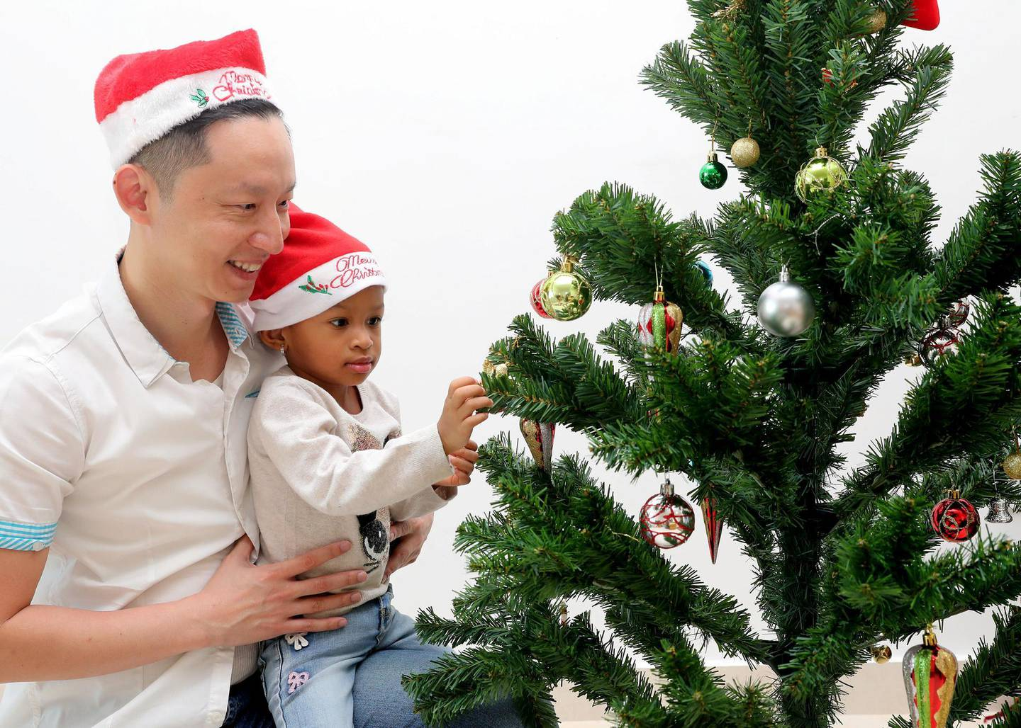 Abu Dhabi, United Arab Emirates - December 05, 2018: Tuan Phan with daughter Alma 2. Tuan is a meteorologist by day who blogs for non-profit community SimplyFI.org, which encourages investors to follow the investment principles established by Jack Bogle, the founder of Vanguard. He is one of the personal finance bloggers talking about their Christmas and Christmas advice to avoid blowing your bank account during the festive season. Wednesday the 5th of December 2018 on Yas Island, Abu Dhabi. Chris Whiteoak / The National