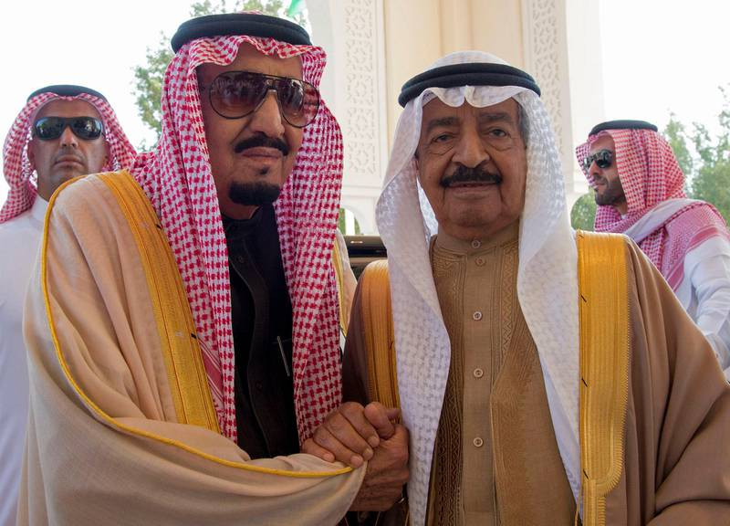 """A handout picture released by the Saudi Press Agency (SPA) shows Saudi King Salman bin Abdulaziz Al-Saud (L) holding hands with Bahraini Prime Minister Khalifa bin Salman Al-Khalifa at the Al-Sakhir Palace in Manama on December 8, 2016. (Photo by HO / SPA / AFP) / RESTRICTED TO EDITORIAL USE - MANDATORY CREDIT """"AFP PHOTO / SPA"""" - NO MARKETING - NO ADVERTISING CAMPAIGNS - DISTRIBUTED AS A SERVICE TO CLIENTS"""