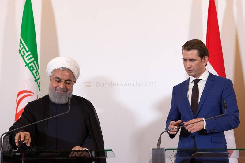 Austria's Chancellor Sebastian Kurz and Iranian President Hassan Rouhani (L) give a joint press conference following a meeting on July 4, 2018 at the Chancellery in Vienna.  / AFP / ALEX HALADA