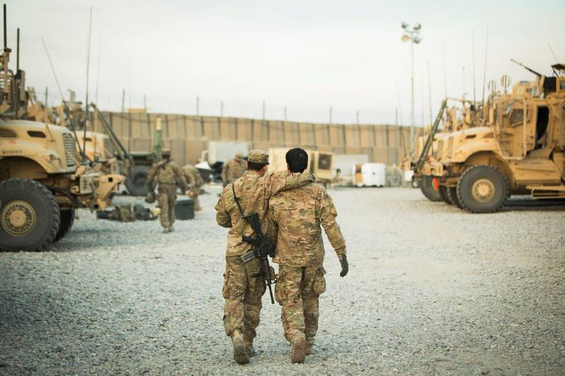 FILE PHOTO: A U.S. soldier from the 3rd Cavalry Regiment walks with the unit's Afghan interpreter before a mission near forward operating base Gamberi in the Laghman province of Afghanistan December 11, 2014. REUTERS/Lucas Jackson/File Photo
