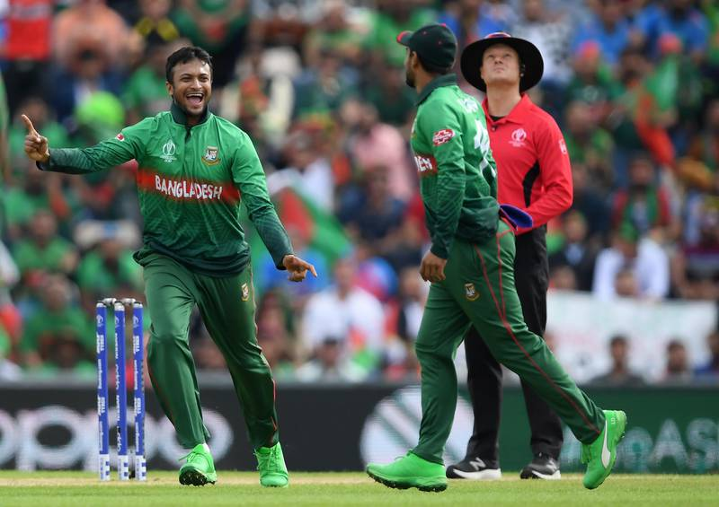 SOUTHAMPTON, ENGLAND - JUNE 24: Shakib Al Hasan (l) of Bangladesh celebrates the wicket of Gulbadin Naib of Afghanistan with Liton Das (r) of Bangladesh during the Group Stage match of the ICC Cricket World Cup 2019 between Bangladesh and South Africa at The Hampshire Bowl on June 24, 2019 in Southampton, England. (Photo by Alex Davidson/Getty Images)