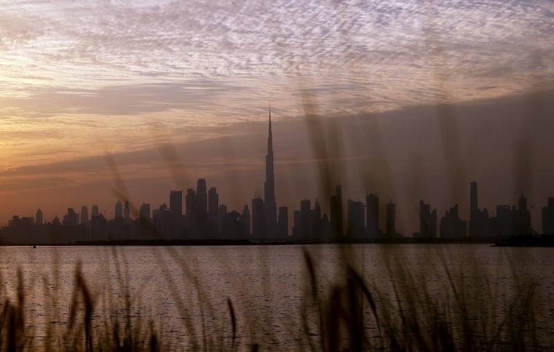 DUBAI, UNITED ARAB EMIRATES - NOVEMBER 29:  The Burj Khalifa, (C) stands surrounded by other skyscrapers on November 29, 2020 in Dubai, United Arab Emirates. The country's government recently decreed that foreigners can fully own local firms, a change from previous law that required foreign investors to have an Emirati partner with at least a 51% stake in the company. Several types of businesses were excluded from the new law, such as those in the energy, telecommunications and transport sectors. (Photo by Francois Nel/Getty Images)