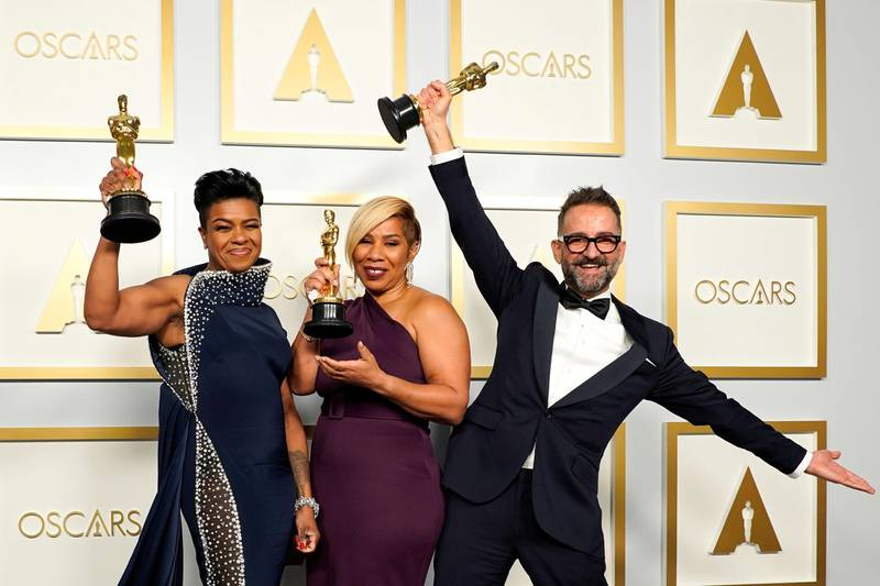 """Mia Neal, Jamika Wilson and Sergio Lopez-Rivera, winners of the award for Best Makeup and Hairstyling for """"Ma Rainey's Black Bottom"""" pose in the press room at the Oscars, in Los Angeles, California, U.S., April 25, 2021. Chris Pizzello/Pool via REUTERS"""
