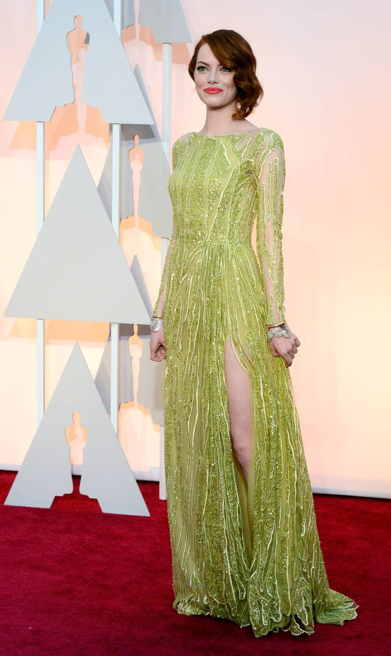 epa04632975 Emma Stone arrives for the 87th annual Academy Awards ceremony at the Dolby Theatre in Hollywood, California, USA, 22 February 2015. The Oscars are presented for outstanding individual or collective efforts in 24 categories in filmmaking.  EPA/MIKE NELSON
