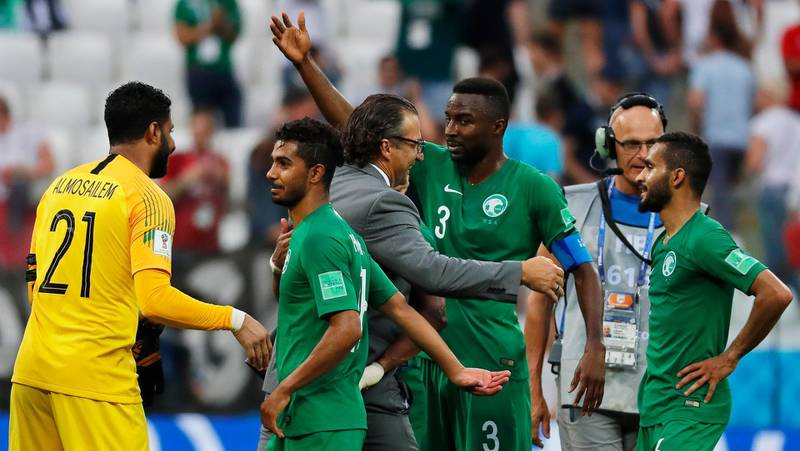 epa06839461 Saudi Arabia's head coach Juan Antonio Pizzi (C-L) celebrates with his players after the FIFA World Cup 2018 group A preliminary round soccer match between Saudi Arabia and Egypt in Volgograd, Russia, 25 June 2018. Saudi Arabia won 2-1.  (RESTRICTIONS APPLY: Editorial Use Only, not used in association with any commercial entity - Images must not be used in any form of alert service or push service of any kind including via mobile alert services, downloads to mobile devices or MMS messaging - Images must appear as still images and must not emulate match action video footage - No alteration is made to, and no text or image is superimposed over, any published image which: (a) intentionally obscures or removes a sponsor identification image; or (b) adds or overlays the commercial identification of any third party which is not officially associated with the FIFA World Cup)  EPA/SERGEI ILNITSKY   EDITORIAL USE ONLY