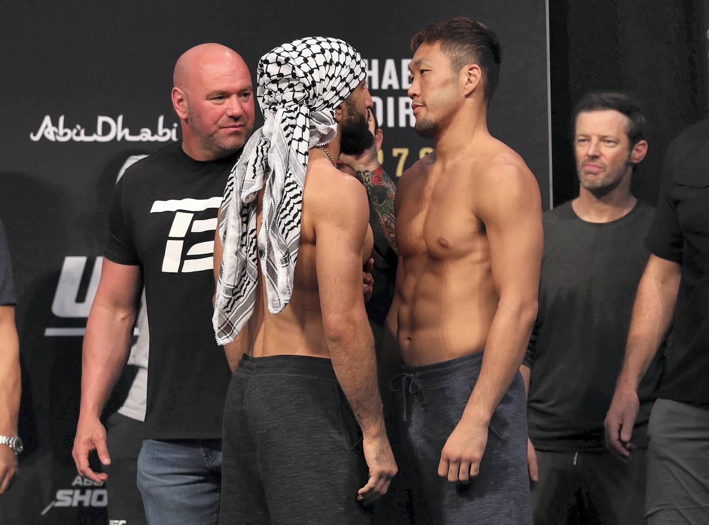 Abu Dhabi, United Arab Emirates - September 06, 2019: Belal Muhammad (L) and Takashi Satō square off at UFC 242. Friday the 6th of September 2019. Yes Island, Abu Dhabi. Chris Whiteoak / The National
