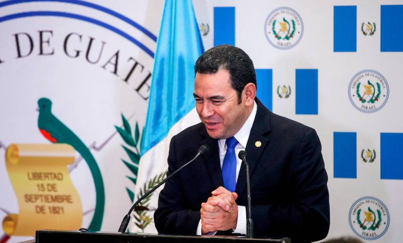 Guatemalan President Jimmy Morales speaks during the inauguration ceremony of the inauguration ceremony of Guatemala's embassy in Jerusalem on May 16, 2018.  Guatemala inaugurated its Israel embassy in Jerusalem on May 15, becoming the first country to follow in the footsteps of the United States' deeply controversial move, breaking with decades of international consensus. / AFP / POOL / RONEN ZVULUN
