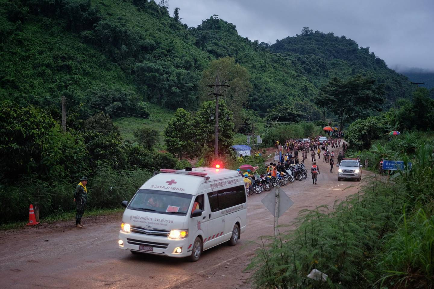 CHIANG RAI, THAILAND - JULY 8: An ambulance carrying one of the boys rescued from Tham Luang Nang Non cave heading towards the hospital on July 8, 2018 in Chiang Rai, Thailand. Divers began an effort to pull the 12 boys and their soccer coach on Sunday morning after they were found alive in the cave at northern Thailand. Videos released by the Thai Navy SEAL shows the boys, aged 11 to 16, and their 25-year-old coach are in good health in Tham Luang Nang Non cave and the challenge now will be to extract the party safely. (Photo by Linh Pham/Getty Images)