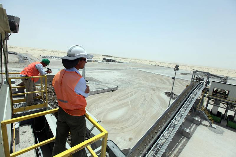 May 10, 2010/ Abu Dhabi /  Andy Baird, front,  a production manager and Josh Maree an engineer for a new recycling plant located at the Al Dhafra Landfill watch as the plant recycles construction and demolition waste.  (Sammy Dallal / The National)